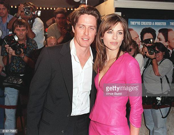 British model and actressproducer Elizabeth Hurley arrives with boyfriend British actor Hugh Grant for the West Coast premiere of the film Mickey...