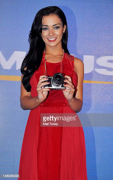 British model and Bollywood film actress Amy Jackson during unveiling of the Olympus OMD EM5 a mirrorless system compact camera in Mumbai on April 17...