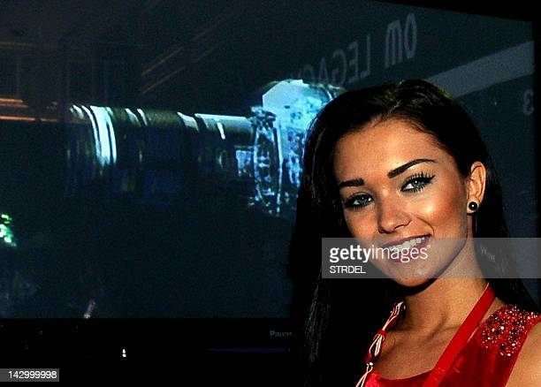 British model and Bollywood film actress Amy Jackson smiles during the unveiling of the Olympus OMD EM5 a mirrorless system compact camera in Mumbai...