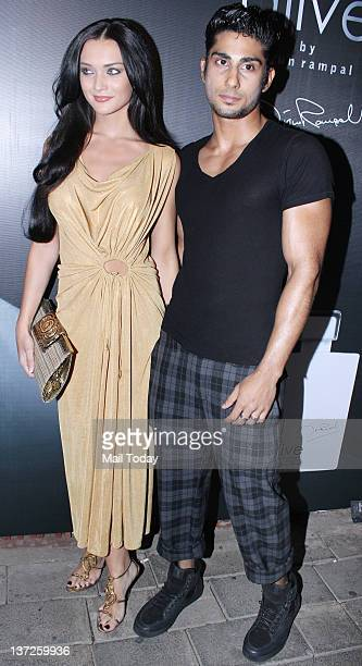 British model and Indian film actress Amy Jackson and actor Prateik Babbar arrive at the launch of Arjun Rampal's perfume Alive in Mumbai