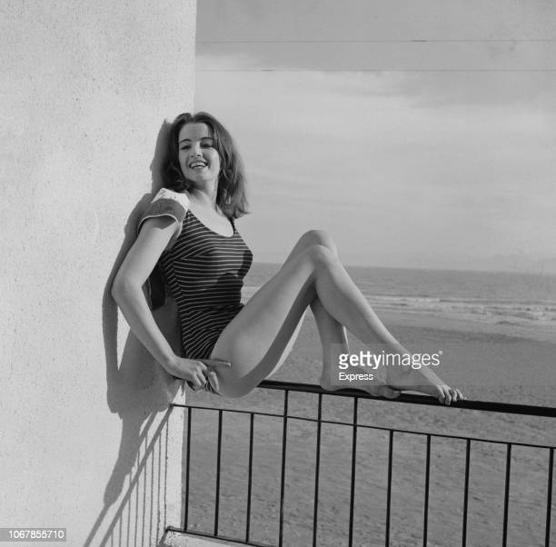 British model and showgirl Christine Keeler sitting on the railing of a balcony in Spain 4th July 1963