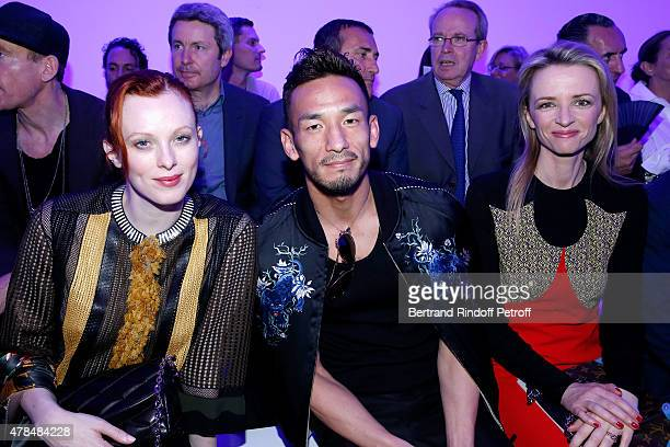 British Model and Singer Karen Elson Football Player Hidetoshi Nakata and Louis Vuitton's executive vice president Delphine Arnault attend the Louis...