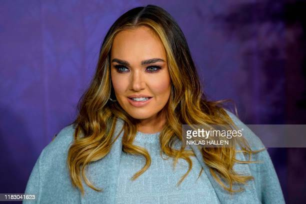 British model and socialite Tamara Ecclestone poses on the red carpet as he arrives to attend the European premiere of the film Frozen 2 in London on...