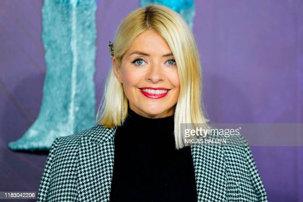 British model and television presenter Holly Willoughby poses on the red carpet as she arrives to attend the European premiere of the film Frozen 2...