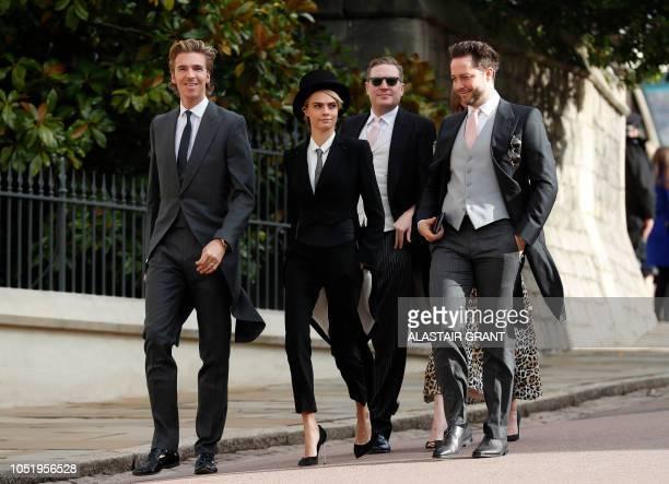 TOPSHOT British model Cara Delevingne arrives with her brotherinlaw James Cook and US journalist Derek Blasberg to attend the wedding of Britain's...