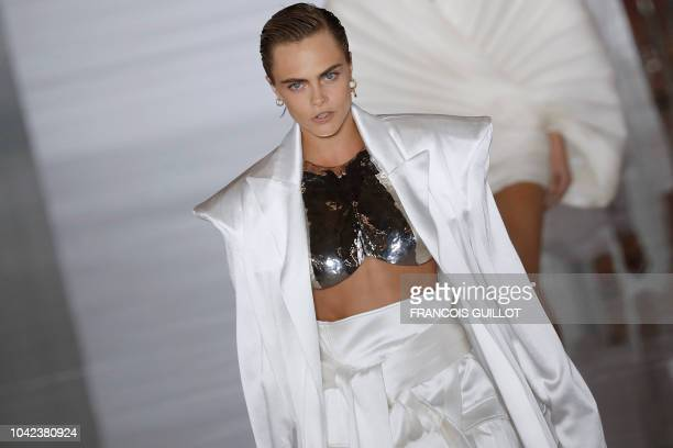 British model Cara Delevingne presents a creation by Balmain during the SpringSummer 2019 ReadytoWear collection fashion show in Paris on September...