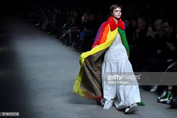 British model Cara Delevingne presents a creation from the Burberry collection during their catwalk show on the second day of London Fashion Week...