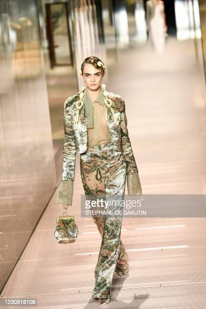 British model Cara Delevingne presents a creation of British designer Kim Jones for the Fendi's Spring-Summer 2021 collection during the Paris Haute...