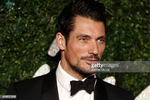 bb0c535858 British model David Gandy poses for pictures on the red carpet upon arrival  to attend the