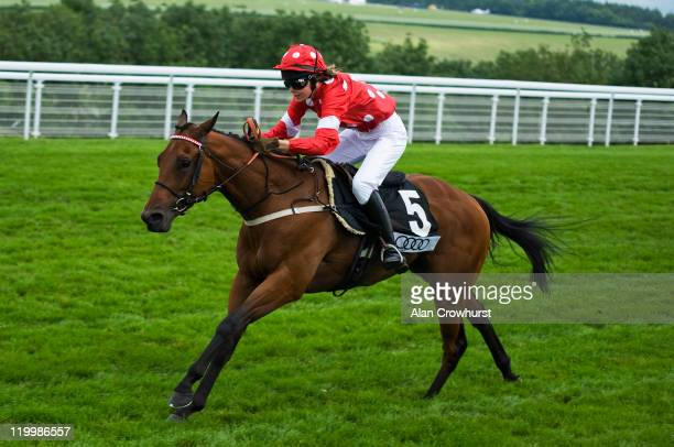 British model Edie Campbell riding Harrodian Hotshot win the charity race at Goodwood racecourse on July 28 2011 in Chichester England