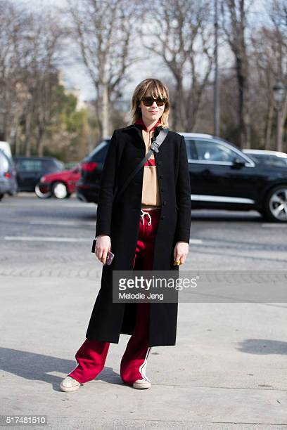 British model Edie Campbell wears a black jacket a Chloé red and tan tracksuit after the Chanel show at Grand Palais on March 07 2016 in Paris France