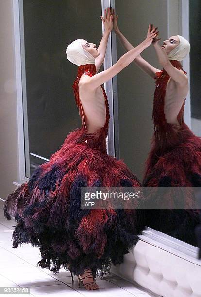 British model Erin O'Connor presents a creation by Alexander Mcqueen for the Spring/Summer collection at London fashion week in London 26 September...