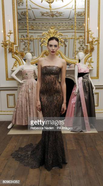 British model Georgia Frost wears a lace print latex ballgown designed by Atsuko Kudo made especially for the Ballgowns British Glamour Since 1950...