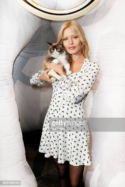 British Model Georgia May Jagger with Grumpy Cat attends the Presentation of the new Opel Calender 2017 at Kraftwerk Mitte on February 1 2017 in...