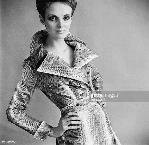 British model Grace Coddington showing a double breasted faux snakeskin raincoat 18th April 1967