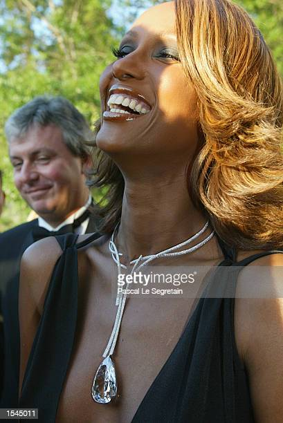 British model Iman arrives at the Moulin de Mougins restaurant to attend an annual AIDS benefit during the 55th annual Cannes Film Festival May 23...