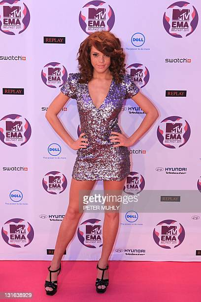 British model Jade Thompson poses on the red carpet at the MTV European Music Awards at the Odyssey Arena in Belfast Northern Ireland on November 6...