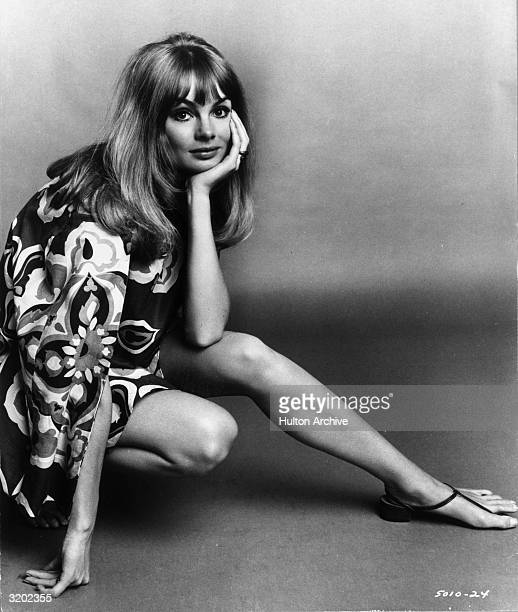 British model Jean 'The Shrimp' Shrimpton rests her face in her palm while crouching in a promotional portrait for director Peter Watkins's film...