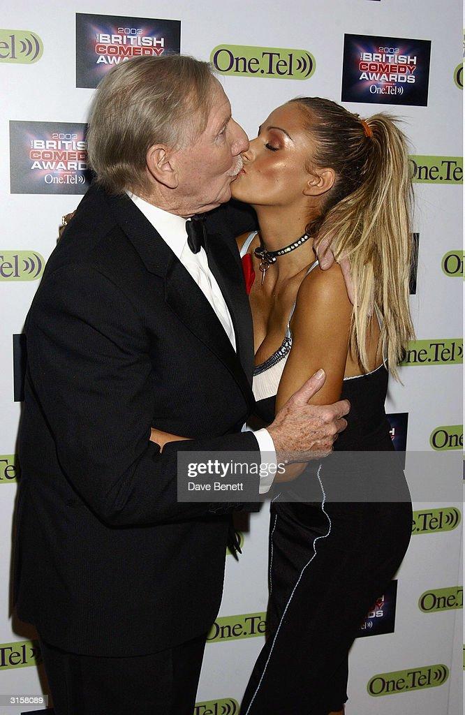 British model Jordan and British inventor Trevor Baylis arrive at the British Comedy Awards held at the London Television Studios on December 10, 2003 in London.
