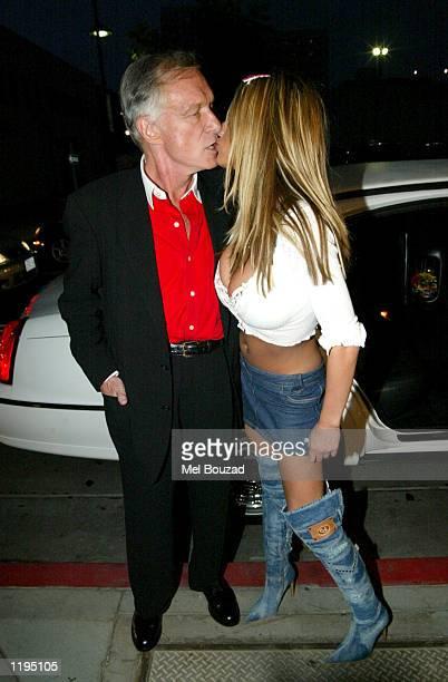 British model Jordan kisses Playboy founder Hugh Hefner outside The Kings Head Pub to promote her Playboy shoot on July 30 2002 in Santa Monica...