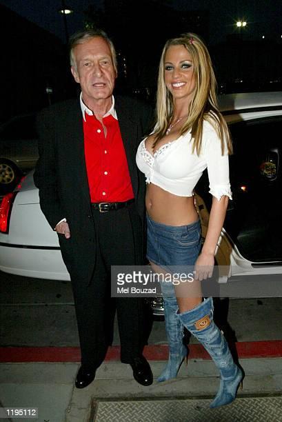British model Jordan poses with Playboy founder Hugh Hefner outside The Kings Head Pub to promote her Playboy shoot on July 30 2002 in Santa Monica...