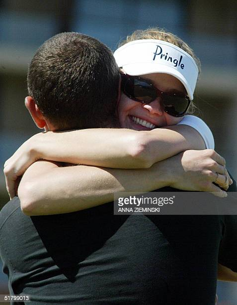 British model Josie Kidd hugs Scottish golfer Andrew Coltart on the 18th hole at the Nelson Mandela Invitational Golf Tournament at Arabella Golf...