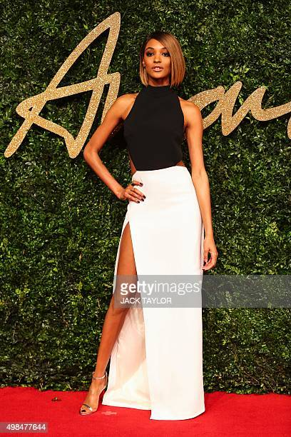 British model Jourdan Dunn poses for pictures on the red carpet upon arrival to attend the British Fashion Awards 2015 in London on November 23 2015...