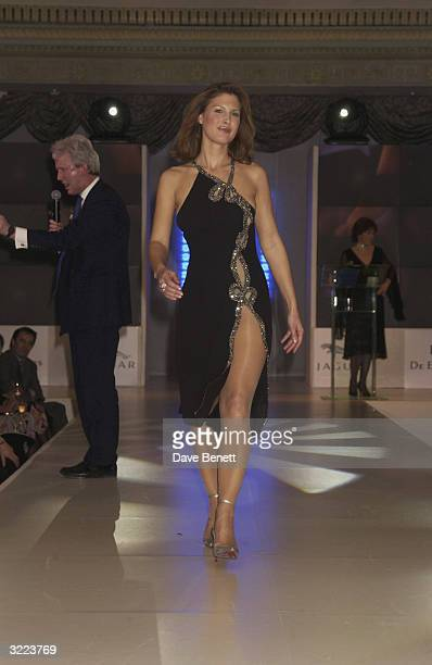 British model Julienne Davis models a Catherine Walker dress at the Little Black Dresses fashion show in aid of the Haven Trust on February 17 2003...