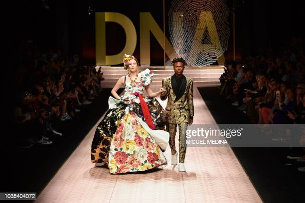British model Karen Elson and Kailand Morris present creations during the Dolce Gabbana fashion show as part of the Women's Spring/Summer 2019...