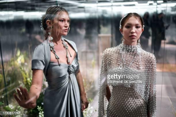 British model Kate Moss and her daughter British model Lila Grace Moss-Hack present creations by British designer Kim Jones for Fendi's Spring-Summer...