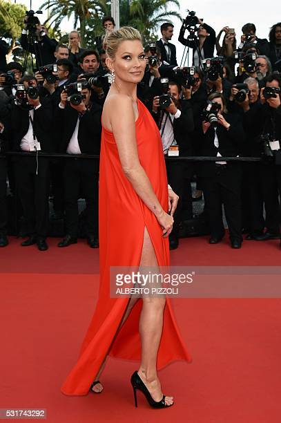 British model Kate Moss arrives on May 16 2016 for the screening of the film 'Loving' at the 69th Cannes Film Festival in Cannes southern France /...