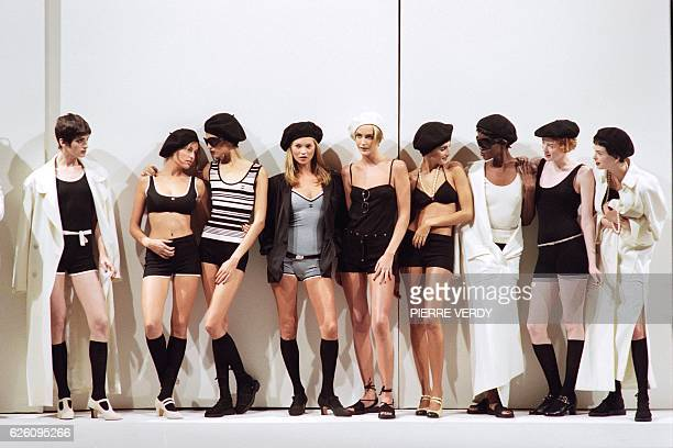 British model Kate Moss French Laetitia Casta and other models show off roughly suits dresses and outfits on October 17 1997 during the presentation...