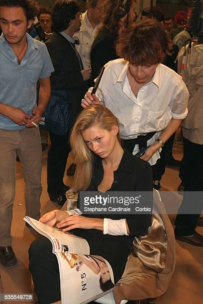 British model Kate Moss having her hair styled in readiness for the Chloe fashion show designed by Karl Lagerfeld