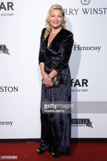 British model Kate Moss poses for a photo on the red carpet of The Foundation for AIDS Research event in Sao Paulo Brazil on April 27 2017