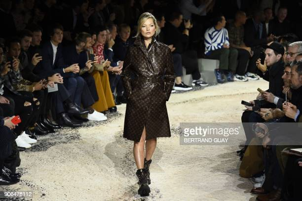 British model Kate Moss presents a creation for Louis Vuitton during the men's Fashion Week for the Fall/Winter 2018/2019 collection in Paris on...
