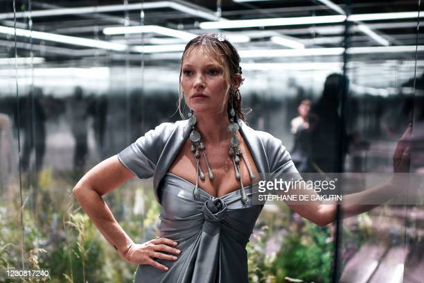 British model Kate Moss presents a creation of British designer Kim Jones for the Fendi's Spring-Summer 2021 collection during the Paris Haute...