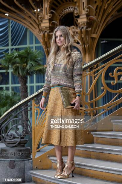 British model Laura Bailey poses during the photocall prior to the 2020 Chanel Croisiere fashion show at the Grand Palais in Paris on May 3 2019
