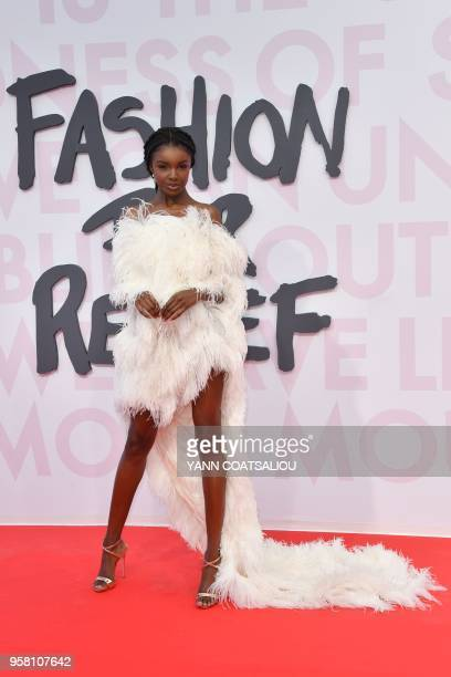 British model Leomie Anderson poses as she arrives on May 13 2018 for the Fashion For Relief Cannes 2018 event on the sidelines of the 71st edition...