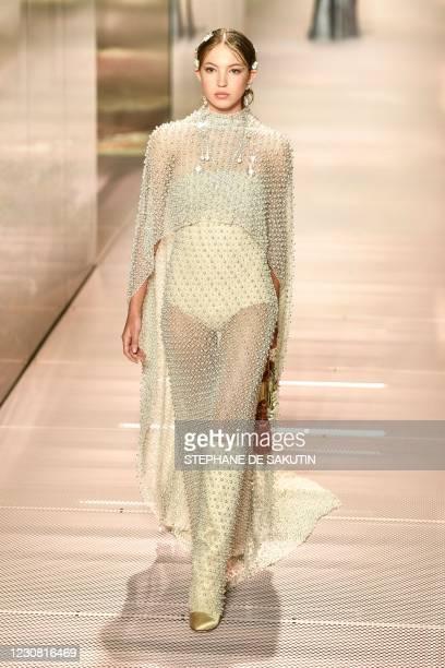 British model Lila Grace Moss presents a creation of British designer Kim Jones for the Fendi's Spring-Summer 2021 collection during the Paris Haute...