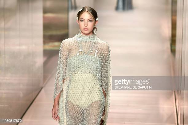 British model Lila Grace Moss-Hack presents a creation by British designer Kim Jones for the Fendi's Spring-Summer 2021 collection during the Paris...