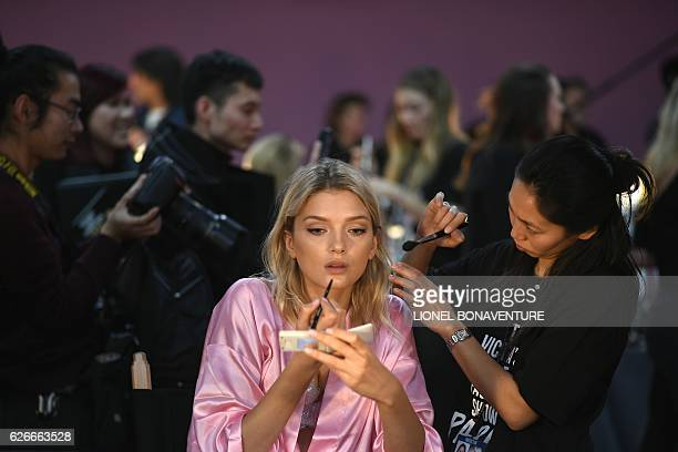 British model Lily Donaldson gets ready backstage for the Victoria's Secret 2016 fashion show at the Grand Palais in Paris on November 30 2016 / AFP...