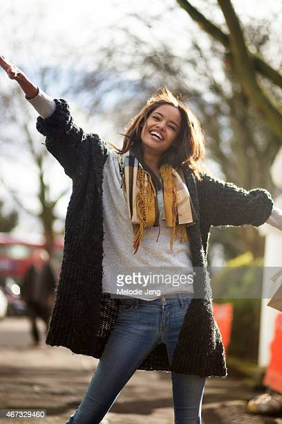 British model Malaika Firth exits the Burberry Prorsum show with a Burberry scarf during London Fashion Week Fall/Winter 2015/16 at Kensington...