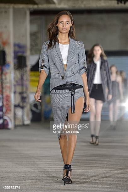 British model Malaika Firth presents a creation by Anthony Vaccarello during the 2015 Spring/Summer readytowear collection fashion show on September...