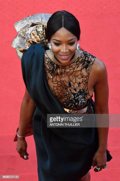 """British model Naomi Campbell poses as she arrives on May 14, 2018 for the screening of the film """"BlacKkKlansman"""" at the 71st edition of the Cannes..."""