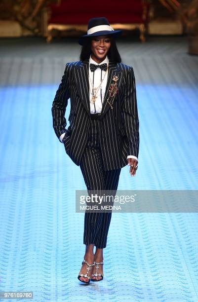 British model Naomi Campbell presents a creation by Dolce Gabbana during the men's women spring/summer 2019 collection fashion show in Milan on June...