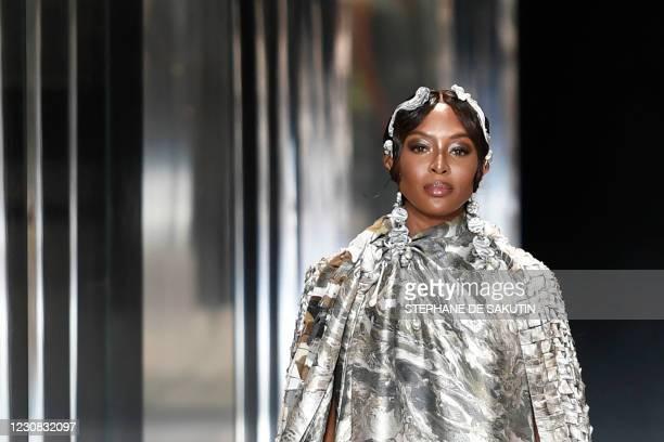 British model Naomi Campbell presents a creation of British designer Kim Jones for the Fendi's Spring-Summer 2021 collection during the Paris Haute...