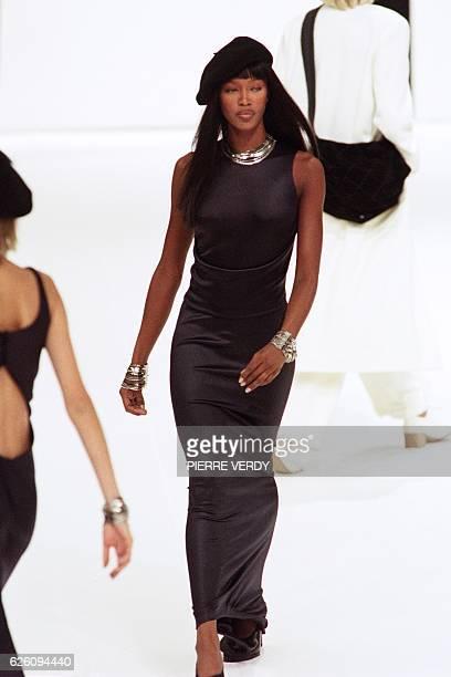 British model Naomi Campbell shows off a black dress on October 17 1997 during the presentation in Paris of Chanel's SpringSummer 98 readytowear...