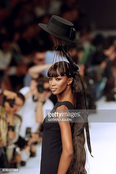 British model Naomi Campbell shows off a creation by Karl Lagerfeld during the presentation of Chanel's FallWinter 1996 highfashion collection in...