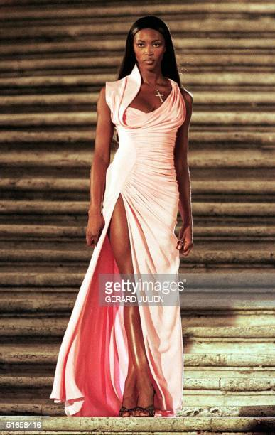 British model Naomi Campbell wears an evening gown by Gianni Versace for 'Donna sotto le stelle' Woman under the stars organized in memory of Italian...