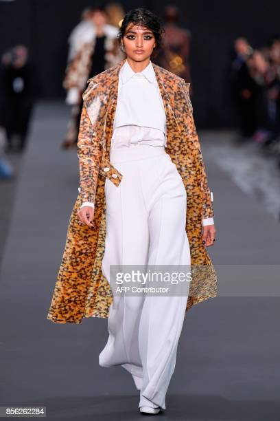 British model Neelam Gill takes part in the L'Oreal fashion which theme is Paris on the sidelines of the Paris Fashion Week on October 1 on a catwalk...